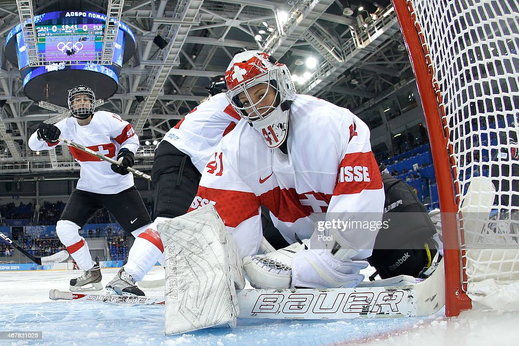 Florence Schelling #41 of Switzerland looks on after a play against Canada during the Women's Ice Hockey Preliminary Round Group A Game on day 1 of the Sochi 2014 Winter Olympics at Shayba Arena on February 8, 2014 in Sochi, Russia.