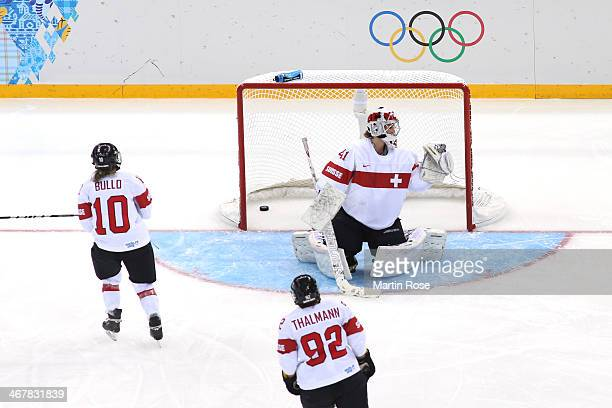 Florence Schelling of Switzerland looks on after Hayley Wickenheiser of Canada scored a goal in the second period during the Women's Ice Hockey...