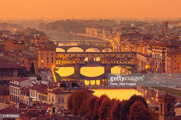 florence skyline at dusk - ponte vecchio stock photos and pictures
