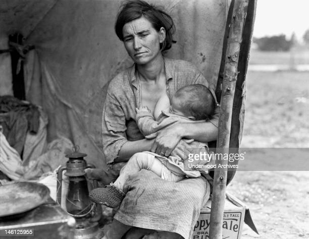 Florence Thompson age 32 nursing one of her children at a pea pickers camp Nipomo California 1936