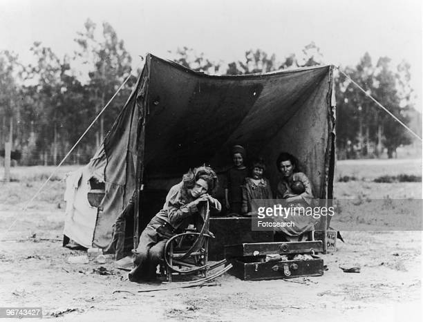 Florence Thompson and her children photographed by Dorothea Lange at a temporary camp in California USA March 1936