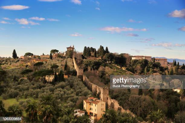 florence town walls, medieval defensive walls, view from the basilica of san miniato al monte. tuscany, italy - san miniato stock pictures, royalty-free photos & images