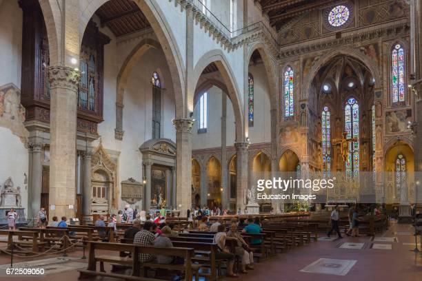 Florence Tuscany Italy Santa Croce Basilica View along length of nave to altar