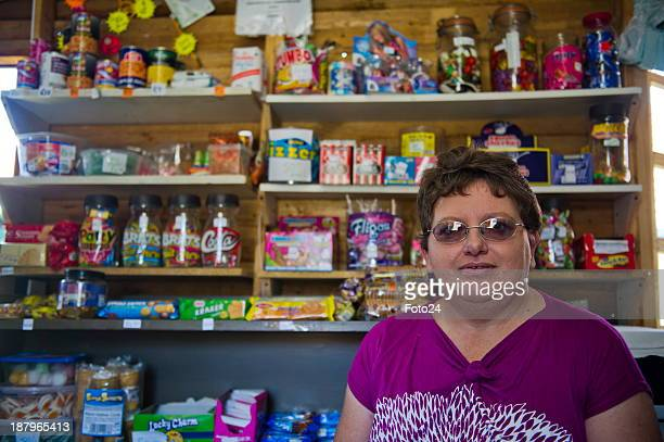 Florence van Niekerk at her spaza shop on November 12 2013 in Kempton Park South Africa She sells airtime bread sweets and cigarettes and also takes...