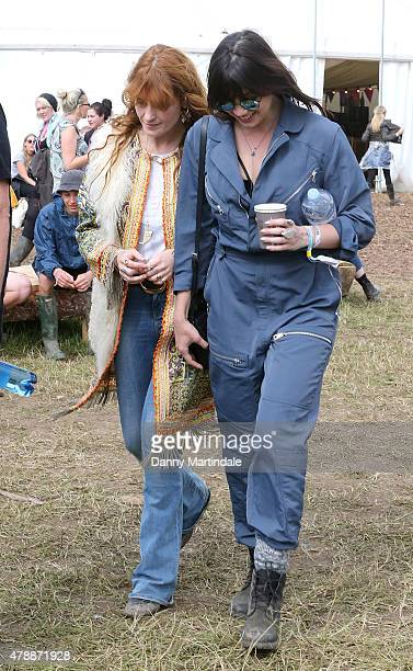 Florence Welch and Daisy Lowe attend the Glastonbury Festival at Worthy Farm Pilton on June 28 2015 in Glastonbury England