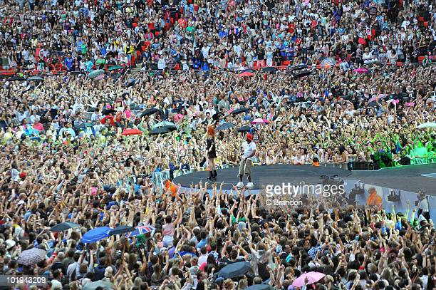 Florence Welch and Dizzee Rascal perform on stage surrounded by crowds at the Capital FM Summertime Ball at Wembley Stadium on June 6 2010 in London...