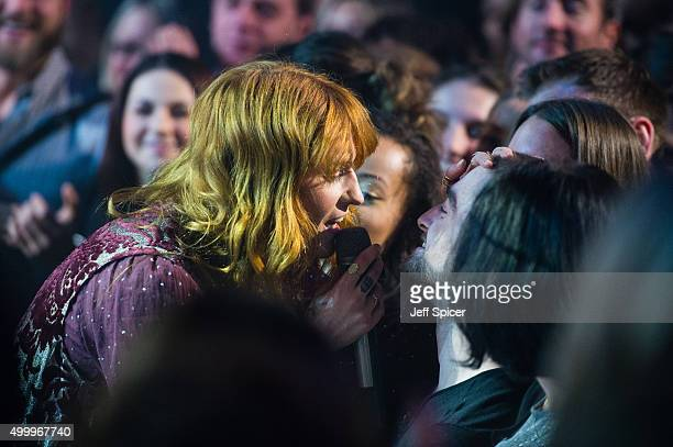 Florence Welch from Florence and the Machine and Daniel Radcliffe during a live broadcast of 'TFI Friday' on December 4 2015 in London England