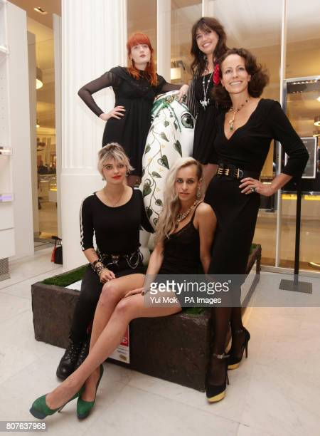 Florence Welch Pixie Geldof Alice Dellal Daisy Lowe and Andrea Dellal pose by the 'Emerald Queen' elephant designed by Sabine Roemer and expected to...