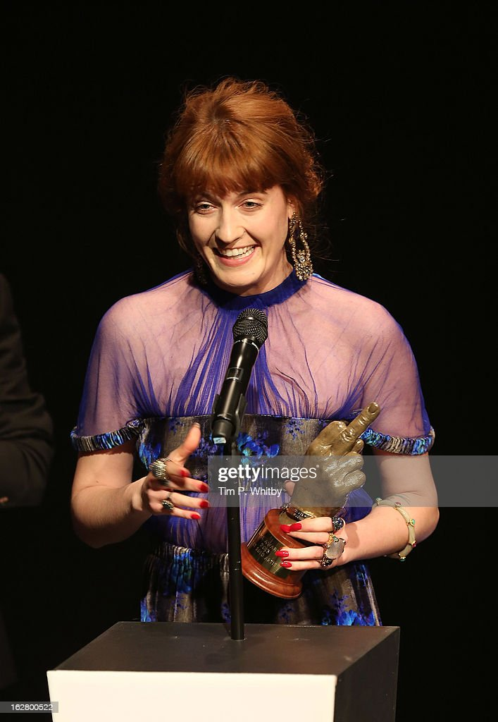 Florence Welch receives the award for Best Solo Artist at the NME Awards 2013 at the Troxy on February 27, 2013 in London, England.