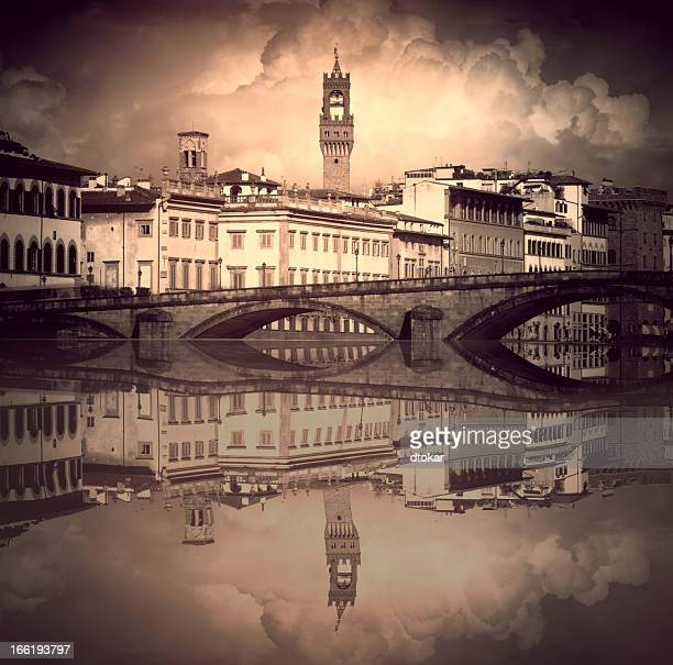 Florence with bridge and it reflection in Italy