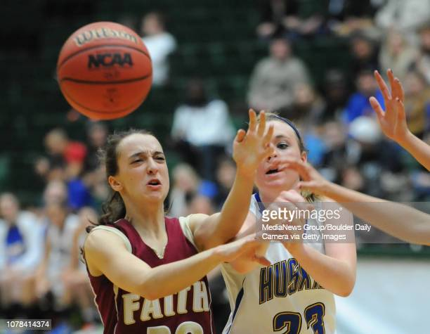 Florence's Kenzie Gordon fights for possession of the ball with Faith Christian's Abigail Chapman during the 3A state Great Eight Game at CSU at Moby...
