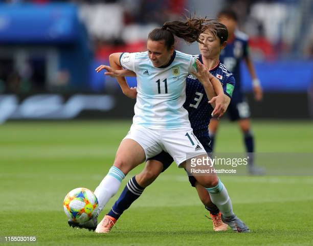 Florencia Bonsegundo of Argentina is challenged by Aya Sameshima of Japan during the 2019 FIFA Women's World Cup France group D match between...