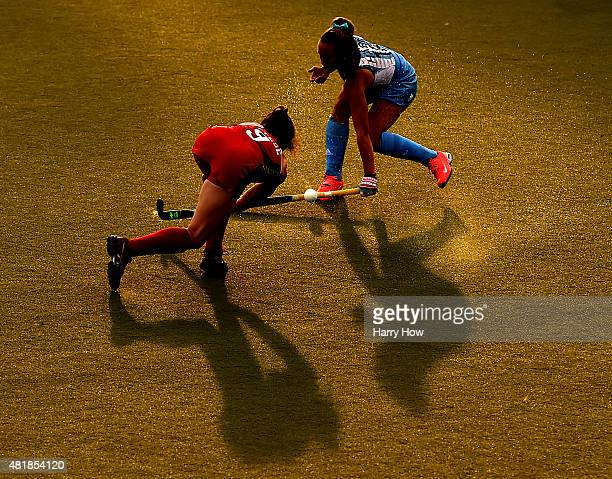 Florencia Habif of Argentina blocks the shot of Michelle Vittese of the United States of America in the women's field hockey gold medal game during...