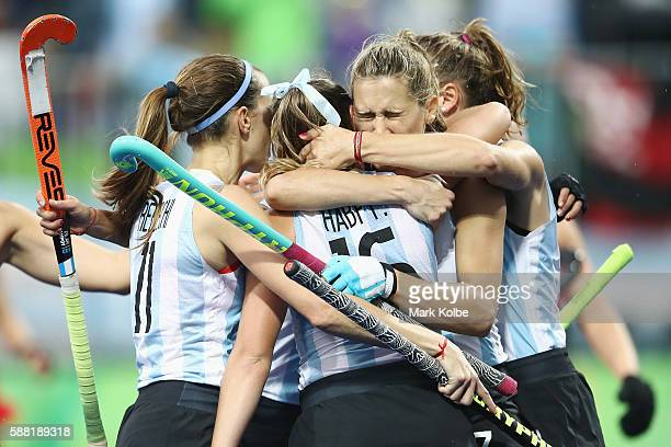 Florencia Habif of Argentina is congratulated by her team after scoring a goal during the women's pool B match between Great Britain and Argentina on...