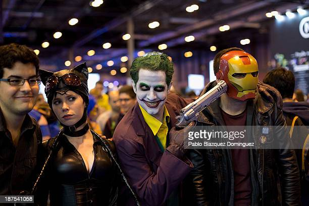 Florencia Muir 21 and Alberto Chaves 25 dressed as 'Catwoman' and 'Joker' pose for a picture at Madrid Games Week in IFEMA on November 9 2013 in...