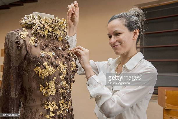 Florencia Soerensen a Paraguayan stylist applies the finishing touches to a chocolate dress made for Philippe Bernachon that will be worn by Sophie...