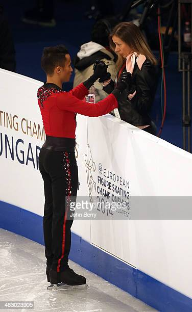 Florent Amodio of France with his coach Katia Krier competes in the men short program of the ISU European Figure Skating Championships 2014 held at...