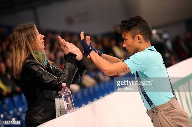 Florent Amodio of France with his coach Katia Krier competes in the Men Free Skating event of the ISU European Figure Skating Championships 2014 held...