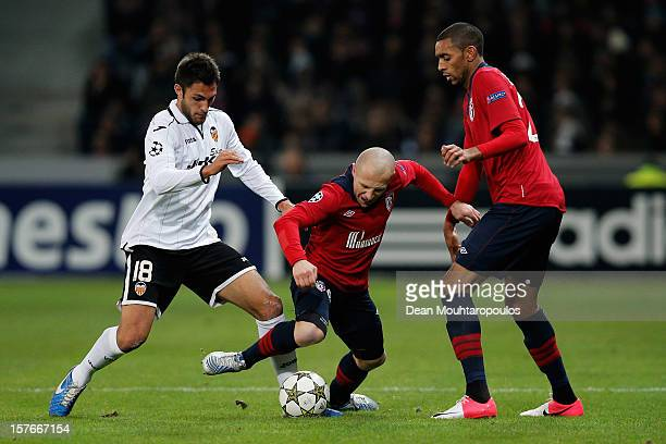 Florent Balmont of Lille and Victor Ruiz of Valencia battle for the ball during the UEFA Champions League Group F match between OSC Lille and...