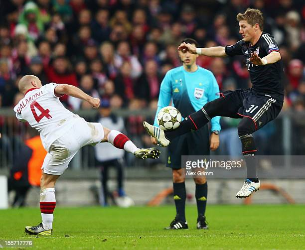 Florent Balmont of Lille is challenged by Bastian Schweinsteiger of Muenchen during the UEFA Champions League group F match between FC Bayern...