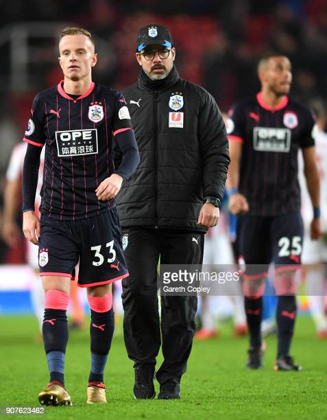 Florent Hadergjonaj of Huddersfield Town and David Wagner Manager of Huddersfield Town following the Premier League match between Stoke City and...