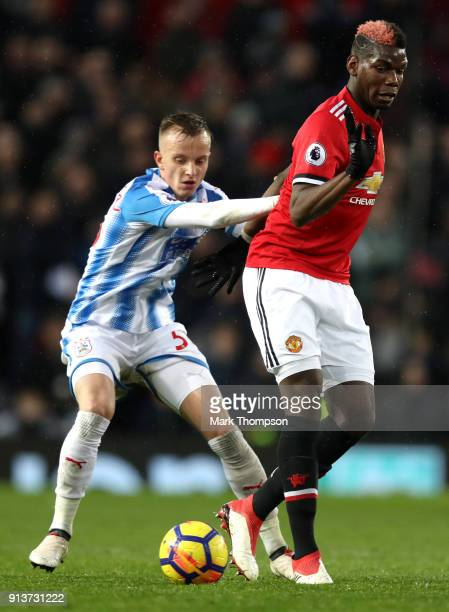 Florent Hadergjonaj of Huddersfield Town and Paul Pogba of Manchester United battles for the ball during the Premier League match between Manchester...