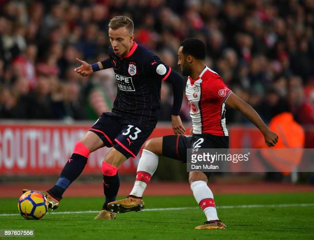Florent Hadergjonaj of Huddersfield Town is challenged by Nathan Redmond of Southampton during the Premier League match between Southampton and...