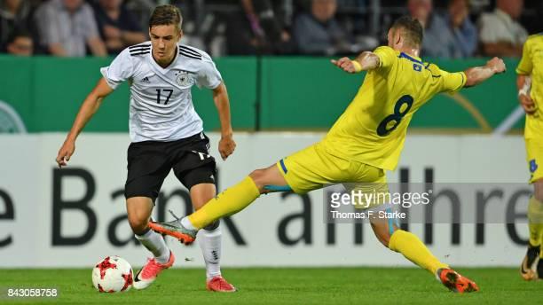 Florent Hasani of Kosovo tackles Florian Neuhaus of Germany during the UEFA Euro 2019 Qualifier match between Germany U21 and Kosovo U21 at Osnatel...