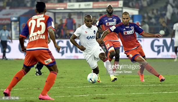 Florent Johan of Delhi Dynamos FC scuffles with FC Pune City during the India Super League football match on October 27 2016 in New Delhi India