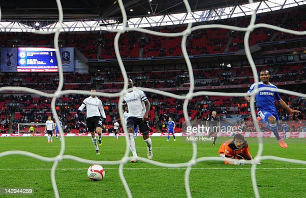 Florent Malouda of Chelsea beats Carlo Cudicini of Tottenham Hotspur as he scores their fifth goal during the FA Cup with Budweiser Semi Final match...