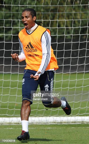 Florent Malouda of Chelsea celebrates a goal during a training session ahead of their third round Carling Cup match against Newcastle United at the...