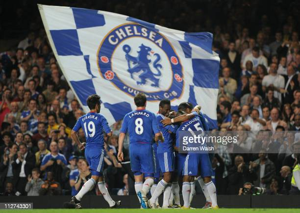 Florent Malouda of Chelsea celebrates after scoring his side's third goal with teammates during the Barclays Premier League match between Chelsea and...
