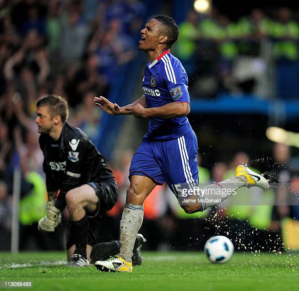 Florent Malouda of Chelsea celebrates after scoring his team's third goal as a dejected Robert Green of West Ham looks on during the Barclays Premier...