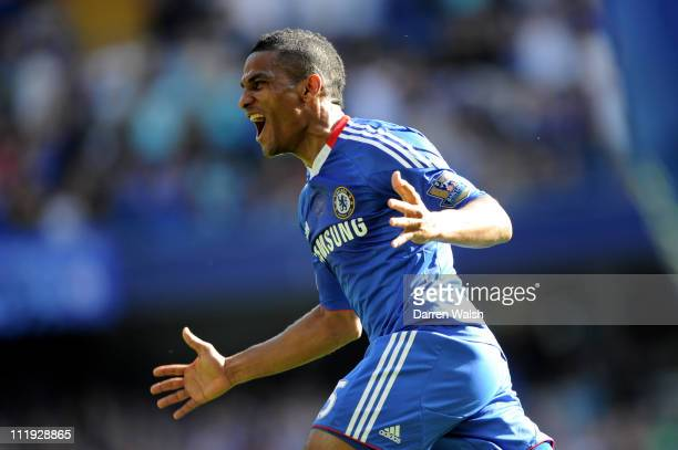 Florent Malouda of Chelsea celebrates after scoring the opening goal during the Barclays Premier League match between Chelsea and Wigan Athletic at...