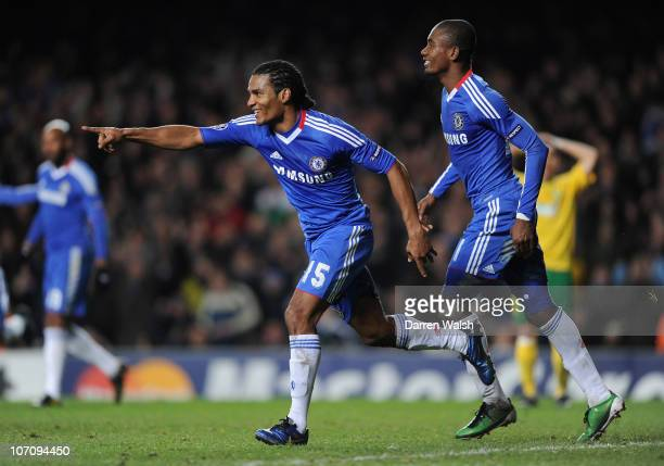 Florent Malouda of Chelsea celebrates scoring his side's second goal with teammate Salomon Kalou during the UEFA Champions League group F match...