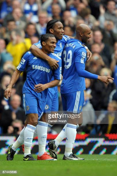 Florent Malouda of Chelsea celebrates scoring the first goal of the game with Didier Drogba and Nicolas Anelka during the Barclays Premier League...