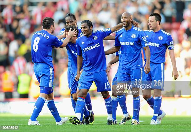 Florent Malouda of Chelsea celebrates victory with his team mates at the end of the Barclays Premier League match between Stoke City and Chelsea at...