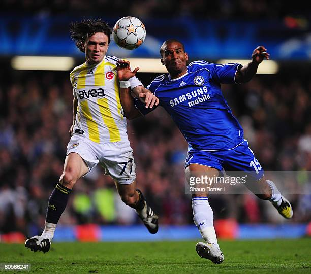 Florent Malouda of Chelsea challenges Gokhan Gonul of Fenerbahce during the UEFA Champions League Quarter Final 2nd Leg match between Chelsea and...