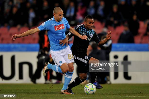 Florent Malouda of Chelsea is closed down by Gokhan Inler of Napoli during the UEFA Champions League round of 16 first leg match between SSC Napoli...