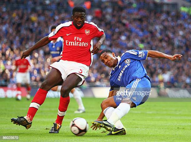 Florent Malouda of Chelsea is closed down by Kolo Toure of Arsenal during the FA Cup sponsored by EON Semi Final match between Arsenal and Chelsea at...