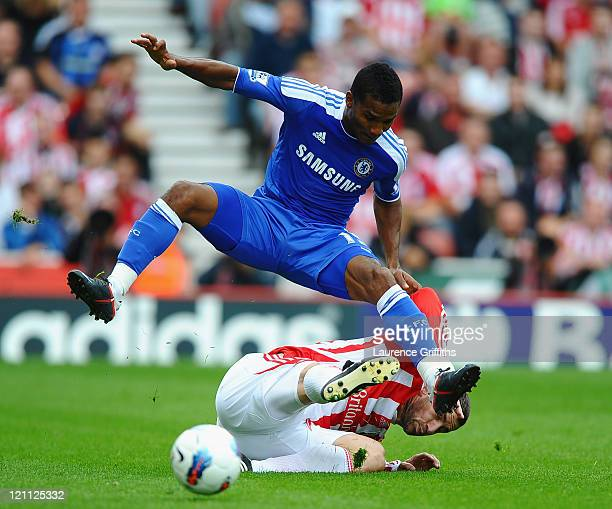Florent Malouda of Chelsea is tackled by Rory Delap of Stoke during the Barclays Premier League match between Stoke City and Chelsea at the Britannia...