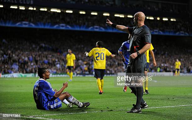 Florent Malouda of Chelsea looks to Referee Tom Henning Ovrebo as he fails to give a for a penalty but instead awarded a free kick outside the area