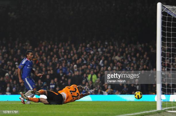 Florent Malouda of Chelsea scores the opening goal past Jussi Jaaskelainen of Bolton Wanderers during the Barclays Premier League match between...