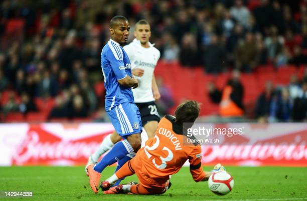 Florent Malouda of Chelsea scores their fifth goal past Carlo Cudicini of Tottenham Hotspur during the FA Cup with Budweiser Semi Final match between...