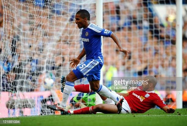 Florent Malouda of Chelsea turns away to celebrate after scoring his team's second goal during the Barclays Premier League match between Chelsea and...