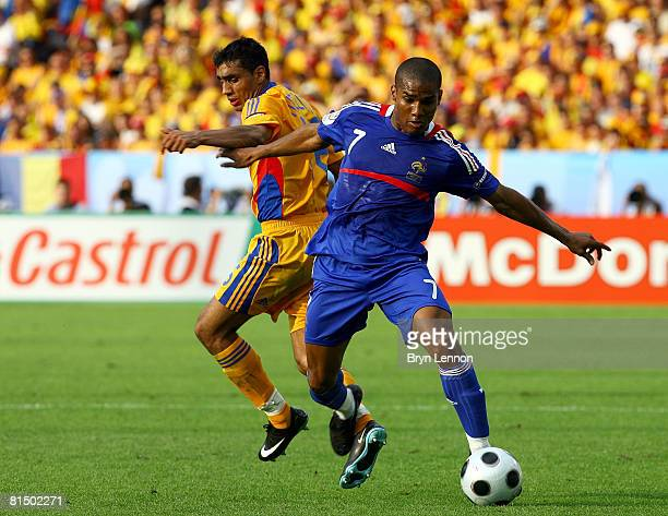Florent Malouda of France and Banel Nicolita of Romania during the UEFA EURO 2008 Group C match between Romania and France at Letzigrund Stadion on...