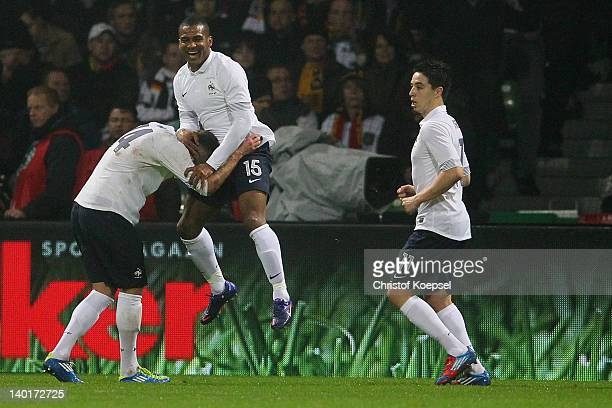 Florent Malouda of France celebrates the second goal with Jeremy Menez during the International friendly match between Germany and France at Weser...