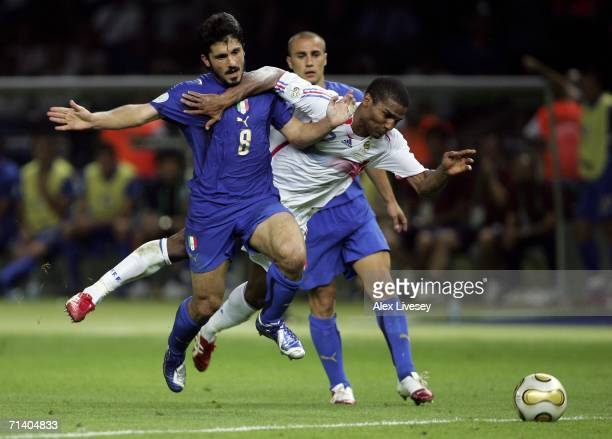 Florent Malouda of France is brought down by Gennaro Gattuso of Italy during the FIFA World Cup Germany 2006 Final match between Italy and France at...