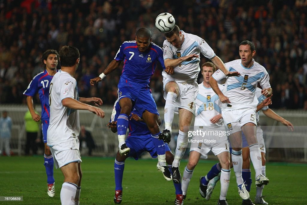 Florent Malouda (#7) of France is challenged by Stephen McManus of Scotland during the Euro 2008 Group B qualifying match between France and Scotland at the Parc de Princes on September 12, 2007 in Paris France.