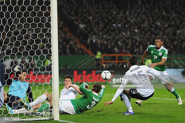 Florent Malouda of France scores his team's second goal during the International friendly match between Germany and France at Weser Stadium on...